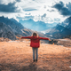 Young woman with raised up arms and mountains at sunset - PhotoDune Item for Sale