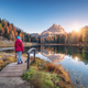 Young wooman on the small wooden bridge against lake - PhotoDune Item for Sale