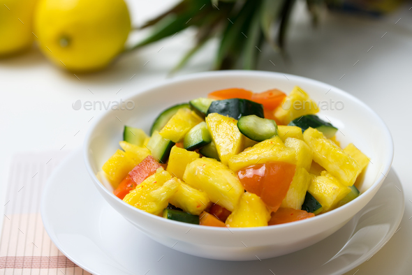 Fruit salad with pineapple, cucumber and tomato - Stock Photo - Images