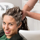 Attractive woman having her hair washed - PhotoDune Item for Sale