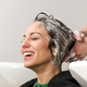 Girl smiling during her hair being washed - PhotoDune Item for Sale