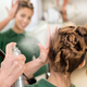 Hairdresser applying hairspray to hairdo - PhotoDune Item for Sale