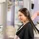Hairdresser combing womans hair in salon - PhotoDune Item for Sale