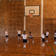 Basketball coach teaching to schoolkids at basketball court in school - PhotoDune Item for Sale
