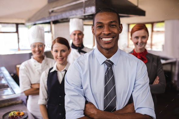 Group of hotel staffs standing with arms crossed in kitchen at hotel - Stock Photo - Images