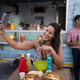 Beautiful woman taking selfie from mobile phone in cafeteria - PhotoDune Item for Sale