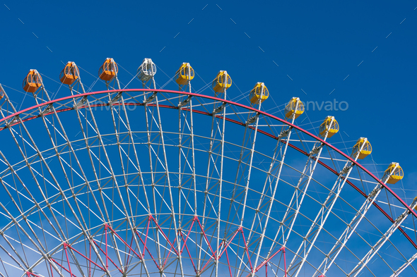 ferris wheel under blue sky - Stock Photo - Images