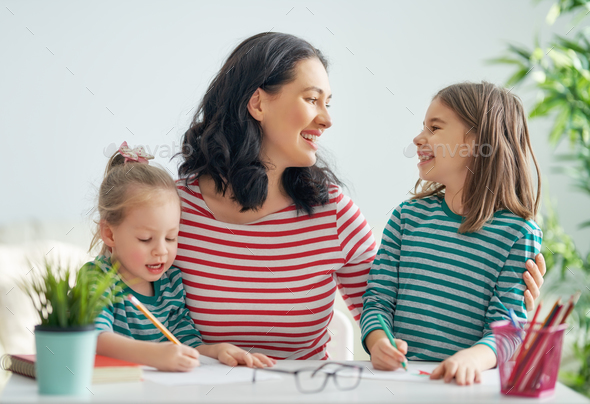 Mother and daughters drawing together - Stock Photo - Images