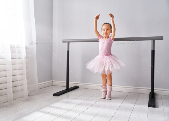 girl is studying ballet. Stock Photo by
