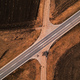 Aerial view of empty road through countryside landscape - PhotoDune Item for Sale