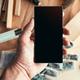 Handyman maintenance worker holding smartphone with blank mock u - PhotoDune Item for Sale