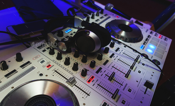 DJ mixer in bright colors disco in a nightclub. - Stock Photo - Images
