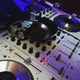 DJ mixer in bright colors disco in a nightclub. - PhotoDune Item for Sale