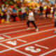 Blurred image of children athletes on a racetrack during finishi - PhotoDune Item for Sale