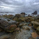 Cloudy and rainy day in a beach full of rocks - PhotoDune Item for Sale
