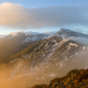 The light of the rising sun clears the mists in the mountains - PhotoDune Item for Sale