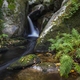 A stream jumps and forms cascades between granite rocks - PhotoDune Item for Sale