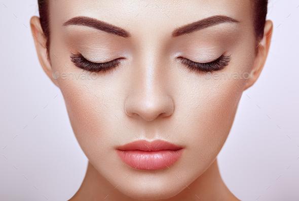 Beautiful woman with long false eyelashes - Stock Photo - Images