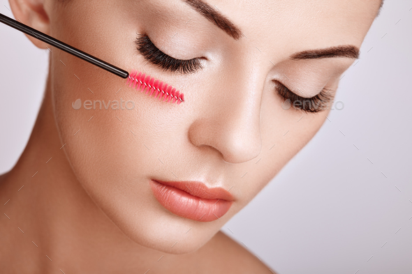 Beautiful woman with long false eyelashes - Stock Photo - Images