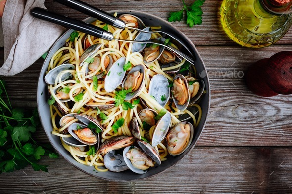 Traditional italian seafood pasta with clams Spaghetti alle Vongole in the pan - Stock Photo - Images