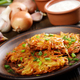 Fresh homemade tasty potato pancakes in clay dish with vegetable - PhotoDune Item for Sale