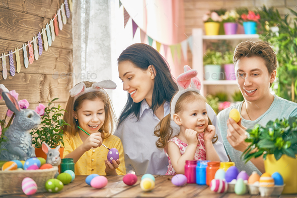 family are painting eggs - Stock Photo - Images
