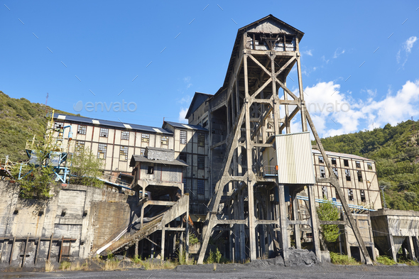 Abandoned coal factory. Industrial rusted machinery. Polluted landscape. Renewable energy - Stock Photo - Images