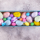 easter colorful eggs painted in bright colors with straw nest in wooden box on stone background - PhotoDune Item for Sale