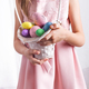 Cute little child holding basket with painted eggs on Easter day. - PhotoDune Item for Sale