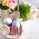 Easter greeting card with glazed cookies and colorful easter eggs in basket . With copy space - PhotoDune Item for Sale