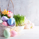 Easter basket filled with colorful hand painted Easter Eggs over a light background - PhotoDune Item for Sale