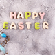 Easter eggs and homemade glazed cookies on a stone background, flat lay - PhotoDune Item for Sale