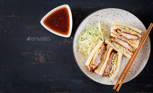 Katsu Sando - food trend japanese sandwich with breaded pork chop, cabbage and tonkatsu sauce. - Stock Photo - Images