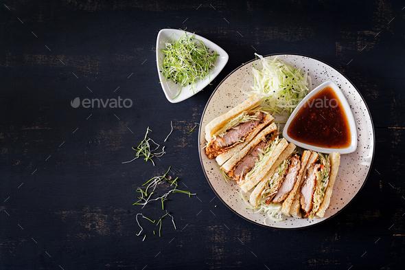 Katsu Sando - food trend japanese sandwich with breaded pork chop, cabbage and tonkatsu sauce. - Stock Photo - Images