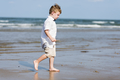 Little boy walking at the beach - PhotoDune Item for Sale