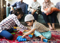 Muslim family relaxing and playing at home - PhotoDune Item for Sale