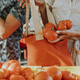Friends buying fresh tomatoes at a farmers market - PhotoDune Item for Sale