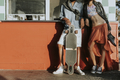Young slim couple posing with a longboard - PhotoDune Item for Sale