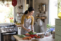 Asian woman busy cooking in the kitchen - PhotoDune Item for Sale