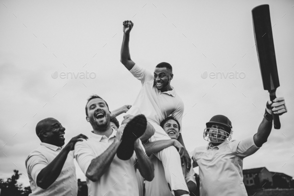 Cheerful cricketers celebrating their victory - Stock Photo - Images