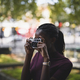 Woman taking photos with a vintage film camera - PhotoDune Item for Sale