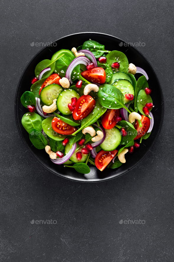Spinach salad with vegetables and nuts - Stock Photo - Images