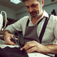 Sewing process of the leather belt. Old Man's hands behind sewing. - PhotoDune Item for Sale
