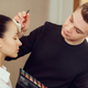 Professional makeup artist working with beautiful young woman - PhotoDune Item for Sale