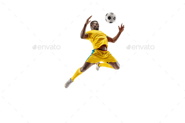 Professional african football soccer player isolated on white background - Stock Photo - Images