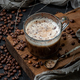 Coffee with milk foam on a wooden board and a scattering of coff - PhotoDune Item for Sale