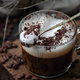 Cappuccino with milk foam in a spoon on a wooden board closeup. - PhotoDune Item for Sale