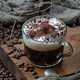 Coffee americano with milk foam and chocolate on a wooden board - PhotoDune Item for Sale