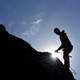 Silhouette of a rock climber hanging on the wall - PhotoDune Item for Sale