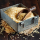 Parboiled rice in a metal box with a wooden spoon - PhotoDune Item for Sale